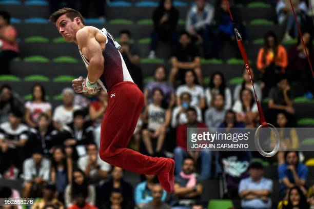 Sam Mikulak from the United States competes on the rings during the final day of the 2018 Pacific Rim Championships in Medellin Antioquia department...