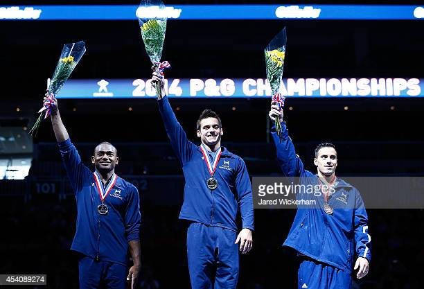 Sam Mikulak John Orozco and Jacob Dalton stand on the podium while accepting their medals in the senior men finals during the 2014 PG Gymnastics...