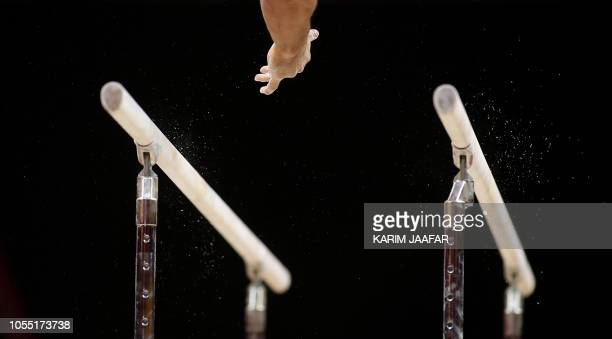 TOPSHOT Sam Mikulak of the US competes in the Men's parallel bars during the Men's Team Final of the 2018 FIG Artistic Gymnastics Championships at...