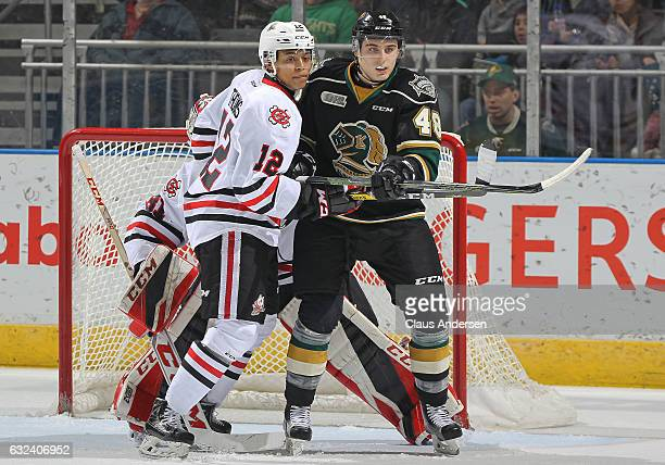 Sam Miletic of the London Knights is held in check by Akil Thomas of the Niagara IceDogs during an OHL game at Budweiser Gardens on January 22 2017...