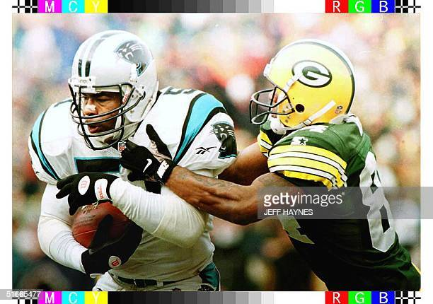 Sam Mills of the Carolina Panthers intercepts a pass intended for Andre Rison of the Green Bay Packers during the first quarter of their NFC...