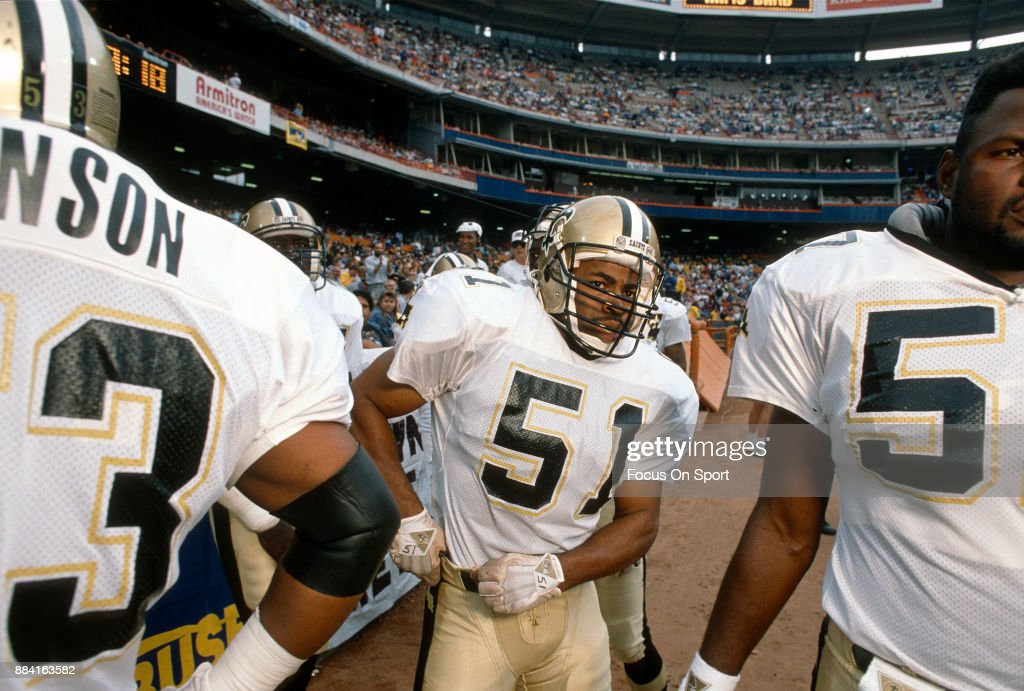 the latest b7d9d 0b42a Sam Mills of the New Orleans Saints looks on during player ...