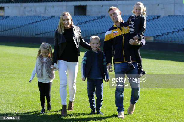 Sam Mitchell and family walk on the oval after speaking to the media announcing his retirement from playing at the end of the home and away season...