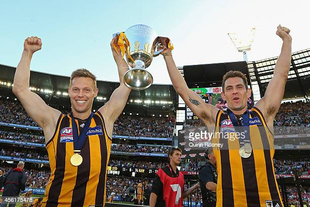 Sam Mitchell and Luke Hodge of the Hawks celebrate with the Premeirship Cup during the 2014 AFL Grand Final match between the Sydney Swans and the...