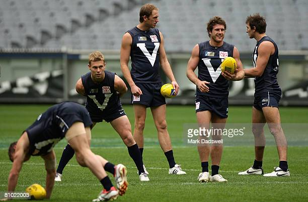 Sam Mitchell Josh Fraser Campbell Brown and Jarrad Waite stretch during a Victoria training session ahead of the AFL Hall of Fame tribute match...