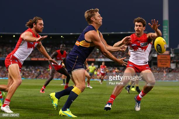 Sam Mitchell of the Eagles handballs during the round four AFL match between the West Coast Eagles and the Sydney Swans at Domain Stadium on April 13...