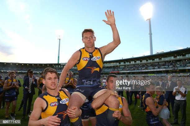 Sam MItchell of the Eagles is chaired from the ground during the round 23 AFL match between the West Coast Eagles and the Adelaide Crows at Domain...