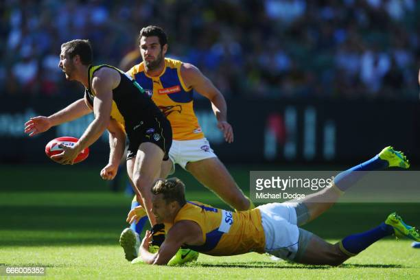 Sam Mitchell of the Eagles tackles Kane Lambert of the Tigers during the round three AFL match between the Richmond Tigers and the West Coast Eagles...