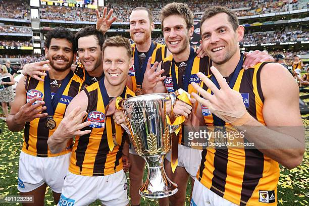 Sam Mitchell of the Hawks and Luke Hodge celebrate the win with teammates during the 2015 AFL Grand Final match between the Hawthorn Hawks and the...
