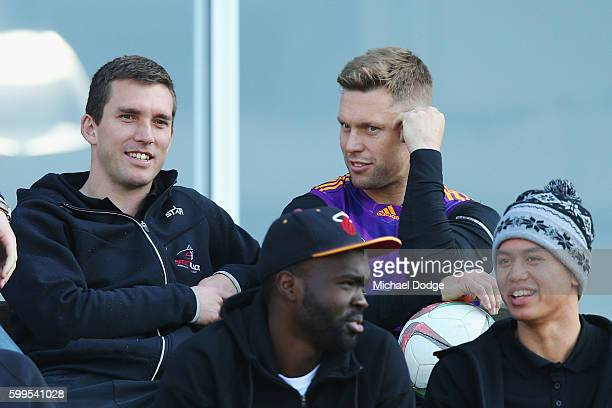 Sam Mitchell of the Hawks catches up with former Premiership teammate Clinton Young during a Hawthorn Hawks AFL training session at Waverley Park on...