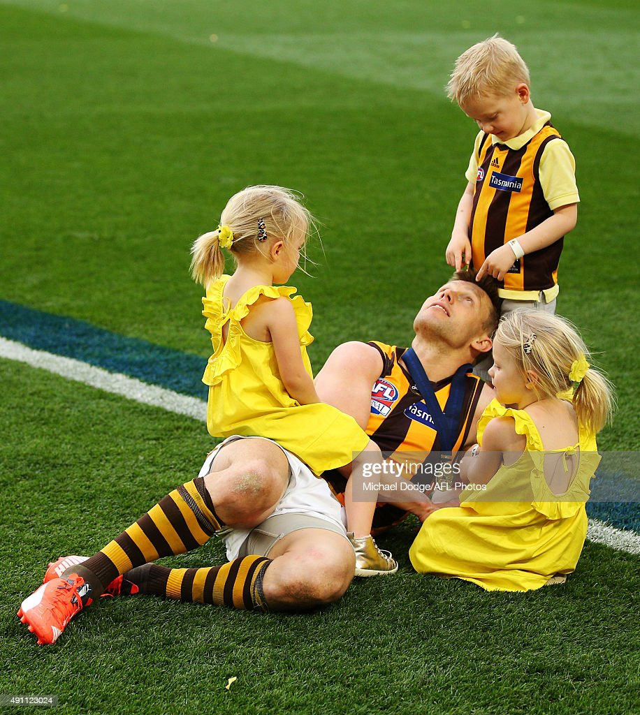 Sam Mitchell of the Hawks celebrates the win with his kids during the 2015 AFL Grand Final match between the Hawthorn Hawks and the West Coast Eagles at Melbourne Cricket Ground on October 3, 2015 in Melbourne, Australia.