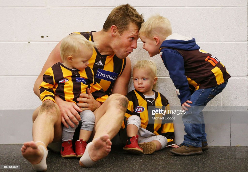 Sam Mitchell of the Hawks celebrates win with his twin daughters Emmerson Mitchell and Scarlett Mitchell and son Smith Mitchell (R) during the round nine AFL match between the Hawthorn Hawks and the Gold Coast Suns at Melbourne Cricket Ground on May 26, 2013 in Melbourne, Australia.