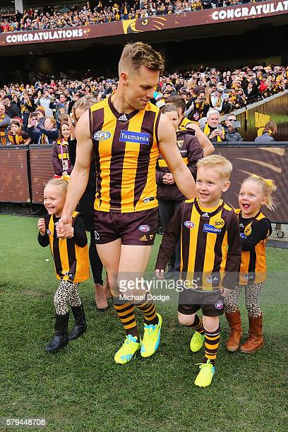 Sam Mitchell of the Hawks comes out with his kids for his 300th match during the round 18 AFL match between the Hawthorn Hawks and the Richmond...