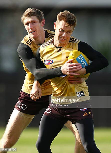 Sam Mitchell of the Hawks is tackled by Ben McEvoy of the Hawks during a Hawthorn Hawks AFL training session at Waverley Park on June 16 2016 in...