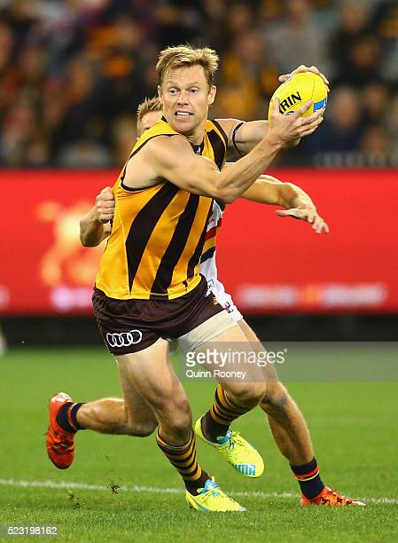 Sam Mitchell of the Hawks is tackled by David Mackay of the Crows during the round five AFL match between the Hawthorn Hawks and the Adelaide Crows...