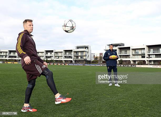Sam Mitchell of the Hawks juggles the ball as Erik Lamela of Tottenham Hotspur looks on during a Tottenham Hotspur player visit to the Hawthorn Hawks...