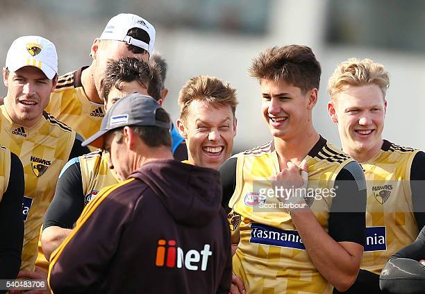 Sam Mitchell of the Hawks laughs as Alastair Clarkson coach of the Hawks speaks and James Sicily of the Hawks look on during a Hawthorn Hawks AFL...
