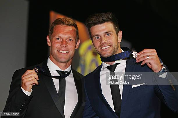 Sam Mitchell of the West Coast Eagles and Trent Cotchin of the Richmond Tigers pose with their Brownlow Medals during the 2012 Brownlow Medal...