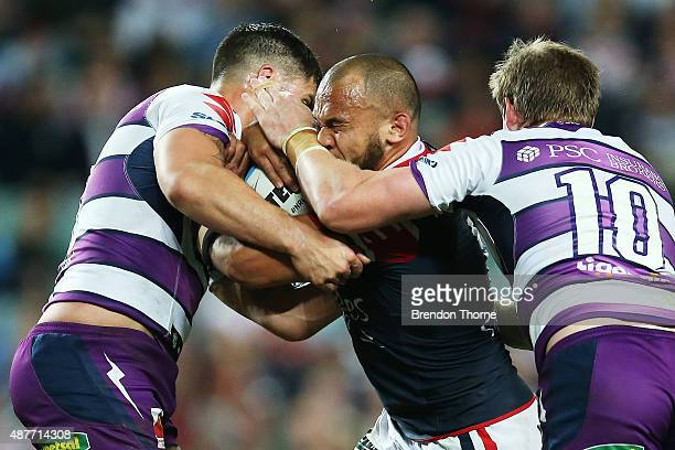 Sam Moa of the Roosters is tackled by Storm defence during the NRL qualifying final match between the Sydney Roosters and the Melbourne Storm at...