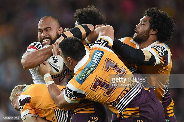 Sam Moa of the Roosters is tackled during the NRL First Preliminary Final match between the Brisbane Broncos and the Sydney Roosters at Suncorp...