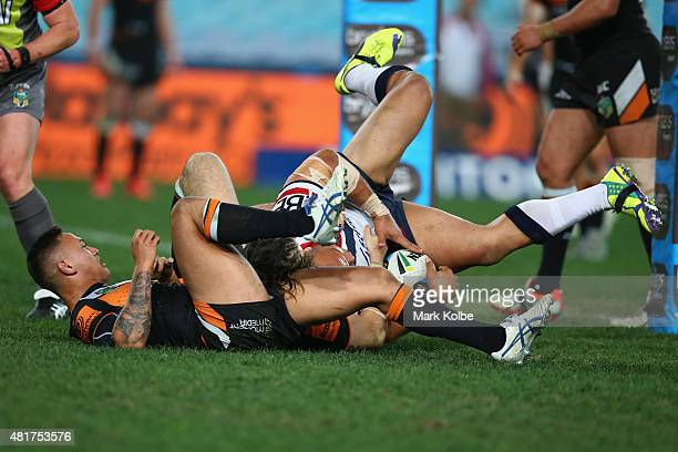 Sam Moa of the Roosters scores a try during the round 20 NRL match between the Wests Tigers and the Sydney Roosters at ANZ Stadium on July 24 2015 in...