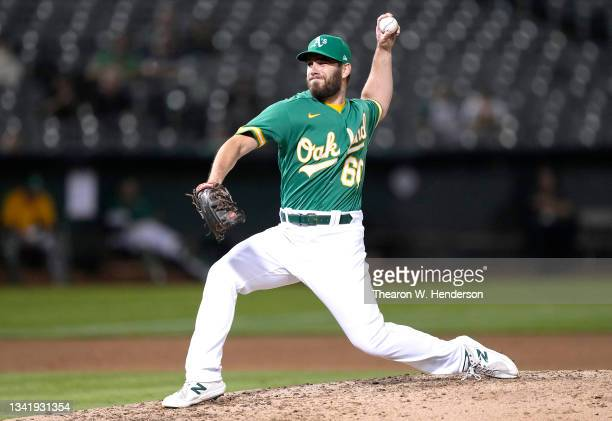 Sam Moll of the Oakland Athletics pitches against the Seattle Mariners in the top of the fifth inning at RingCentral Coliseum on September 21, 2021...