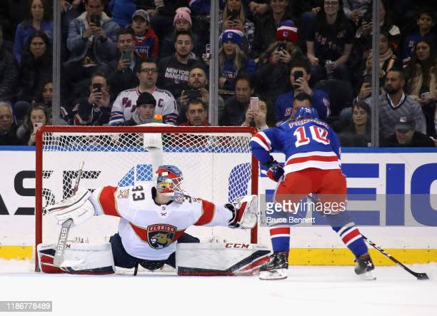 Sam Montembeault of the Florida Panthers makes the shootout save against Artemi Panarin of the New York Rangers at Madison Square Garden on November...