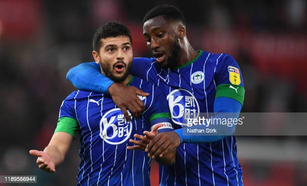 Sam Morsy is consulted by Cheyenne Dunkley of Wigan Athletic during the Sky Bet Championship match between Stoke City and Wigan Athletic at Bet365...