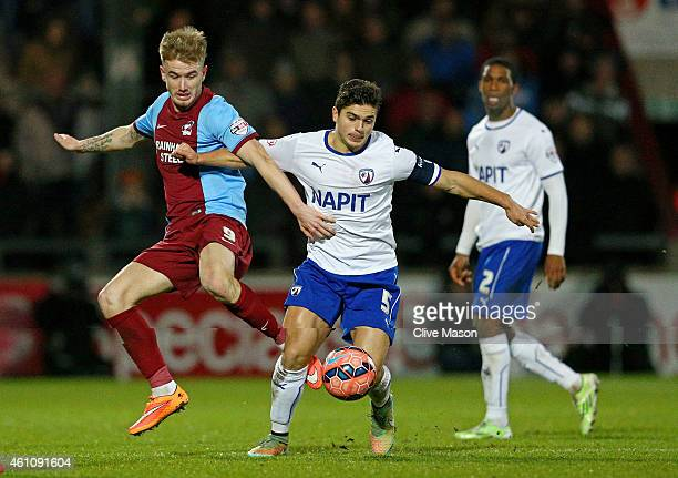 Sam Morsy of Chesterfield holds off the challenge from Paddy Madden of Scunthorpe during the FA Cup Third Round match between Scunthorpe United and...
