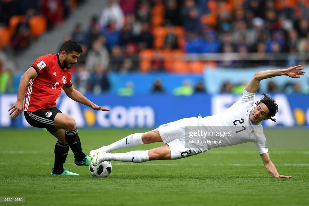Sam Morsy of Egypt and Edinson Cavani of Uruguay battle for possession during the 2018 FIFA World Cup Russia group A match between Egypt and Uruguay at Ekaterinburg Arena on June 15, 2018 in Yekaterinburg, Russia.