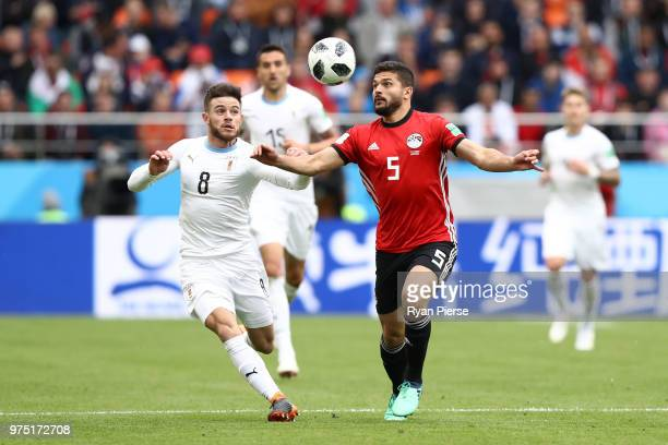 Sam Morsy of Egypt is challenged by Nahitan Nandez of Uruguay during the 2018 FIFA World Cup Russia group A match between Egypt and Uruguay at...
