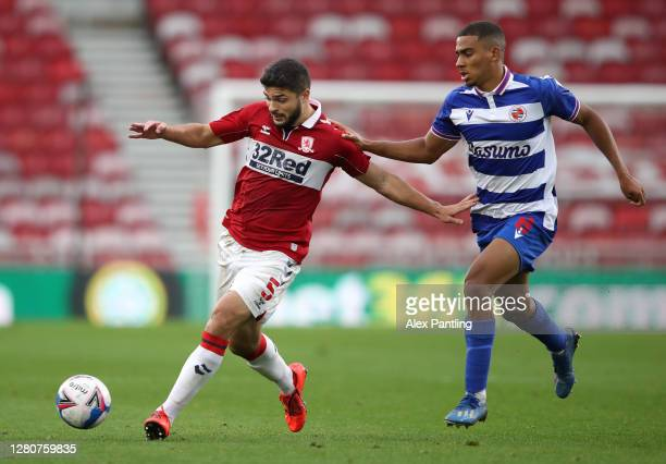 Sam Morsy of Middlesbrough holds off Andy Rinomhota of Reading FC during the Sky Bet Championship match between Middlesbrough and Reading at...