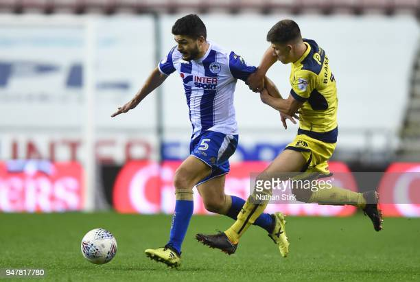 Sam Morsy of Wigan Athletic and Cameron Brannagan of Oxford United in action during the Sky Bet League One match between Wigan Athletic and Oxford...