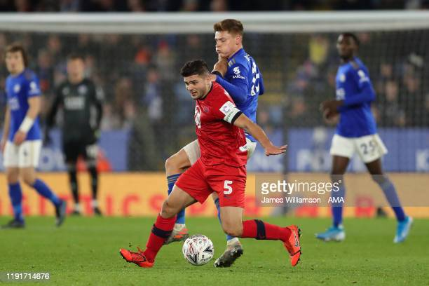 Sam Morsy of Wigan Athletic and Harvey Barnes of Leicester City during the FA Cup Third Round match between Leicester City and Wigan Athletic at The...