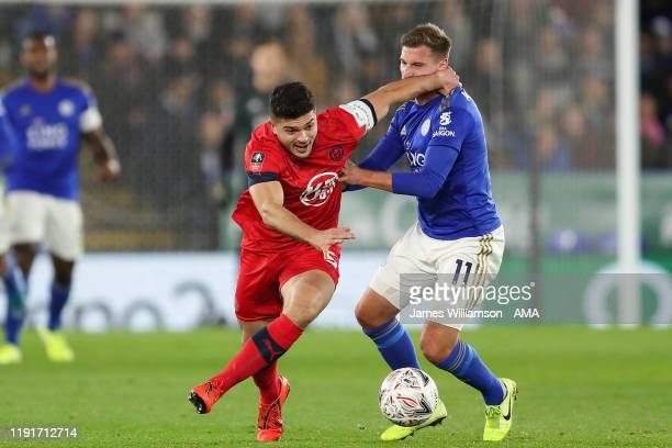 Sam Morsy of Wigan Athletic and Marc Albrighton of Leicester City during the FA Cup Third Round match between Leicester City and Wigan Athletic at...