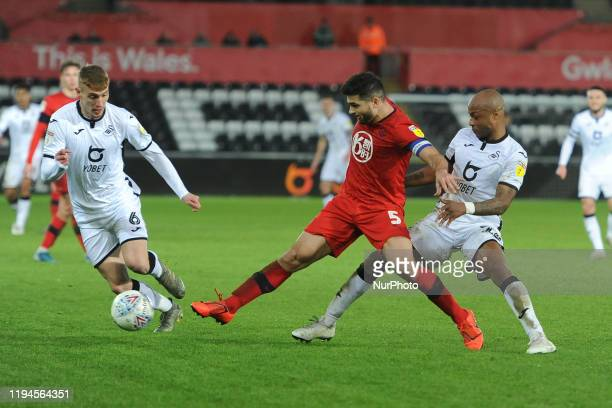 Sam Morsy of Wigan Athletic battle for possession with Andre Ayew of Swansea City during the Sky Bet Championship match between Swansea City and...