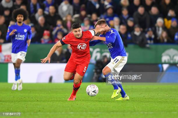Sam Morsy of Wigan Athletic fouls Marc Albrighton of Leicester City during the FA Cup Third Round match between Leicester City and Wigan Athletic at...