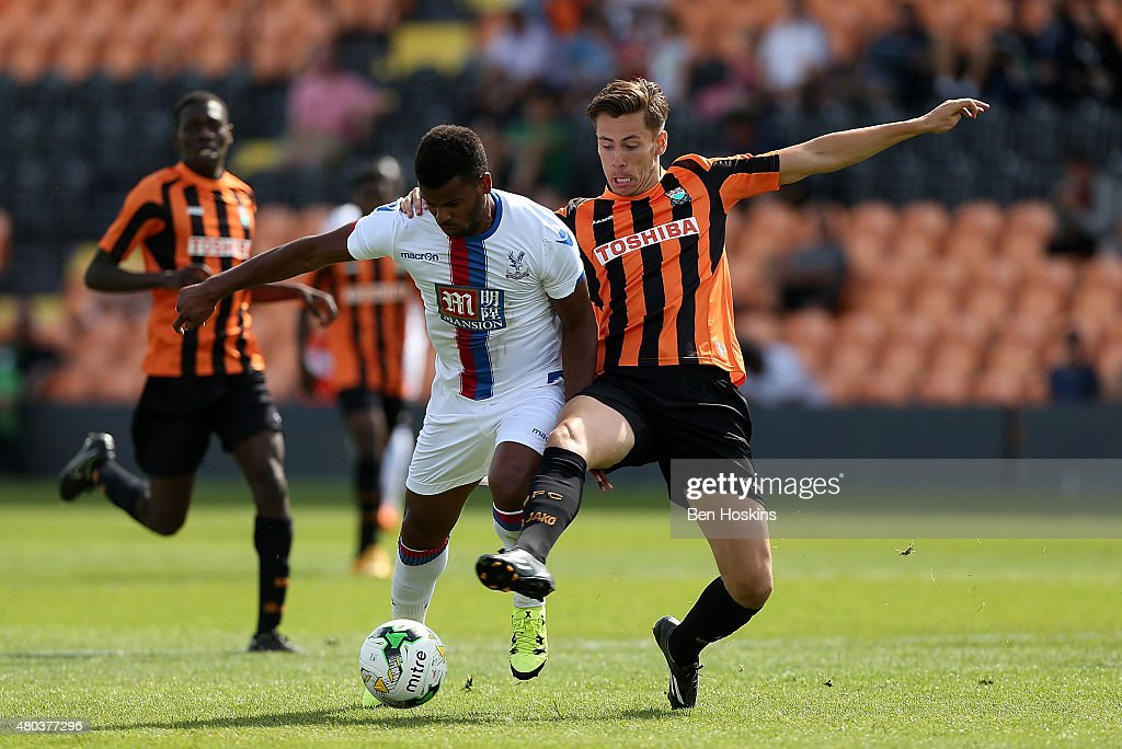 Sam Muggleton of Barnet Challenges Fraizer Campbell of Crystal Palace during a Pre Season Friendly between Barnet and Crystal Palace at The Hive on July 11, 2015 in Barnet, England.