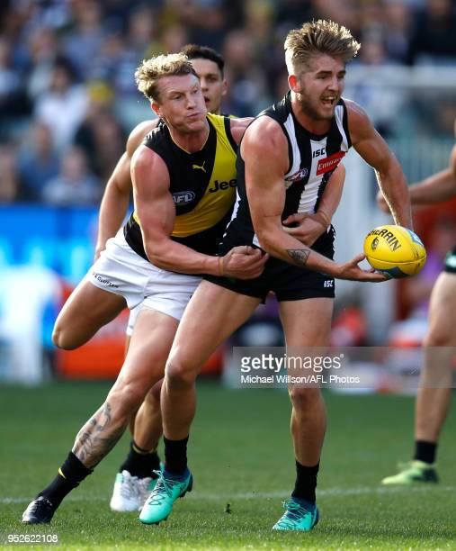 Sam Murray of the Magpies is tackled by Josh Caddy of the Tigers during the 2018 AFL round six match between the Collingwood Magpies and the Richmond...