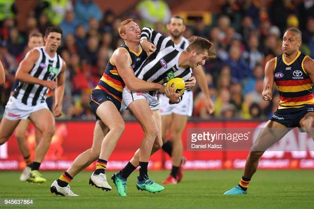 Sam Murray of the Magpies is tackled by Tom Lynch of the Crows during the round four AFL match between the Adelaide Crows and the Collingwood Magpies...