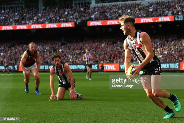 Sam Murray of the Magpies looks upfield during the round five AFL match between the Collingwood Magpies and the Essendon Bombvers at Melbourne...