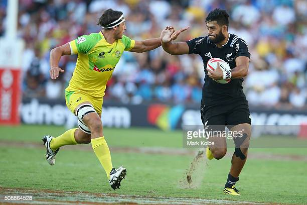 Sam Myers of Australia tackles Akira Ioane of New Zealand during the 2016 Sydney Sevens cup final match between Australia and New Zealand at Allianz...