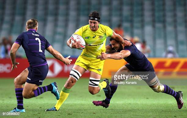 Sam Myers of Australia takes on the defence in the match against Scotland during day two of the 2018 Sydney Sevens at Allianz Stadium on January 27...