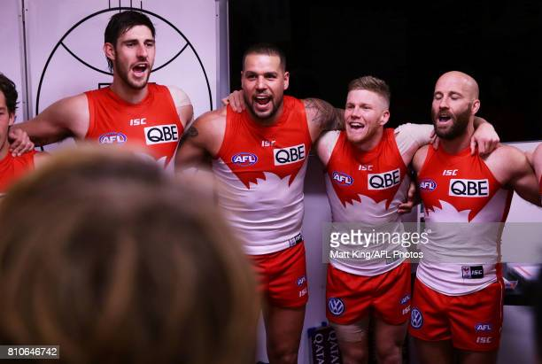 Sam Naismith Lance Franklin Daniel Hannebery and Jarrad McVeigh of the Swans sing the club song after the round 16 AFL match between the Sydney Swans...