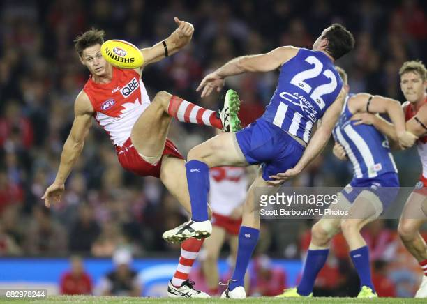 Sam Naismith of the Swans and Todd Goldstein of the Kangaroos compete for the ball during the round eight AFL match between the North Melbourne...