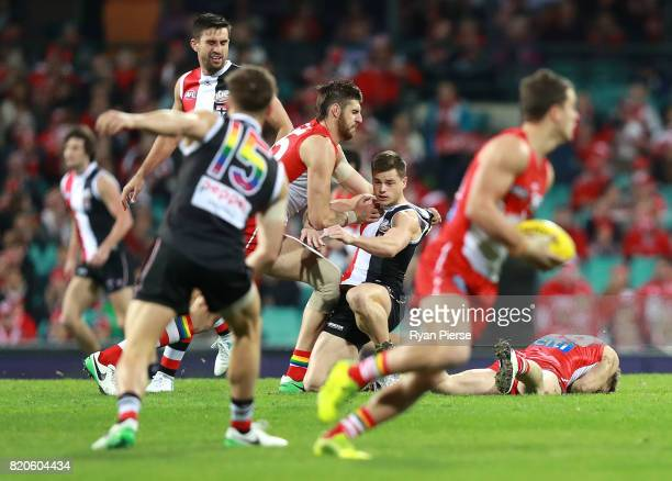 Sam Naismith of the Swans clashes with Jack Sinclair of the Saints after he clashed with Luke Parker of the Swans during the round 18 AFL match...