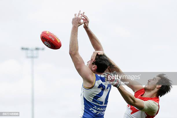 Sam Naismith of the Swans collects Todd Goldstein of the Kangaroos high during the round 22 AFL match between the North Melbourne Kangaroos and the...