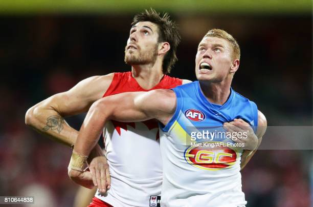 Sam Naismith of the Swans competes for the ball against Peter Wright of the Suns during the round 16 AFL match between the Sydney Swans and the Gold...