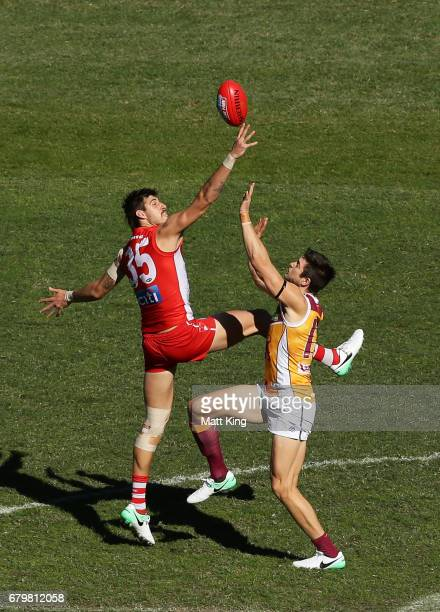 Sam Naismith of the Swans competes for the ball against Stefan Martin during the round seven AFL match between the Sydney Swans and the Brisbane...