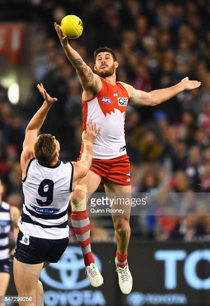 Sam Naismith of the Swans competes in the ruck against Zac Smith of the Cats during the Second Semi Final AFL match between the Geelong Cats and the...